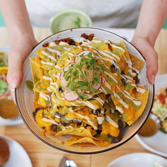 Food such as the towering nachos has a masterful quality