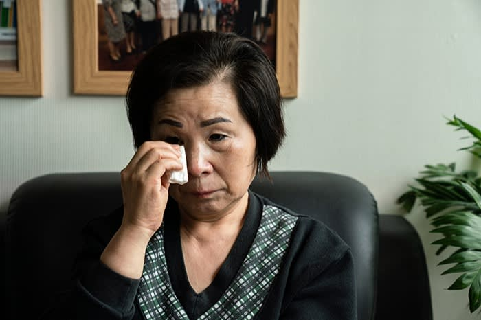 Son Myung-hwa sheds tears as she talks about her father's case