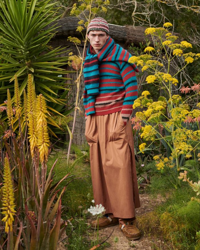 Paul Smith wool jumper, £350, and wool cardigan (around shoulders), £400. Umit Benan cotton kaftan, £920, cotton trousers, £590, and cotton hat, £170. Nick Fouquet – Federico Curradi suede and shearling shoes, £623