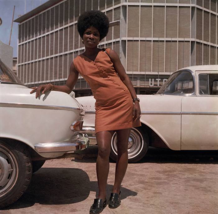 Store assistant on Station Road, Accra, 1971, by James Barnor