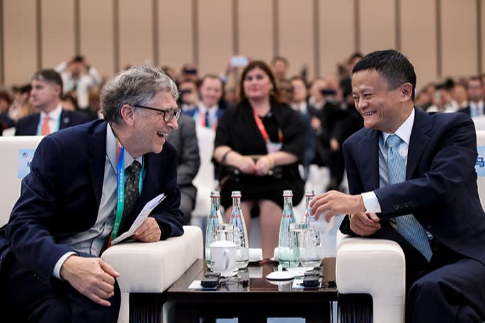 Ma sits at a table with Microsoft's Bill Gates at the China International Import Expo in Shanghai in 2018