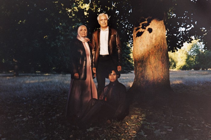 Shahina Anwar, left, primary school teaching assistant, wears  Berluti deerskin jacket, POA. Dress and headscarf, model's own.Jamshed Anwar, right, professor in computational chemistry at Lancaster University, wears Berluti deerskin jacket, £5,400. Canali cotton dress shirt, £195, and jeans, £310. John Lobb calfskin Croft shoes, £1,180. Belt, model's own.Haniyyah Anwar, seated, tech company worker, singer and poet running monthly workshops, 'Poetry in the Park', wears Berluti deerskin shirt, matching roll neck and trousers, all POA. John Lobb calfskin Lawry boots, £1,365