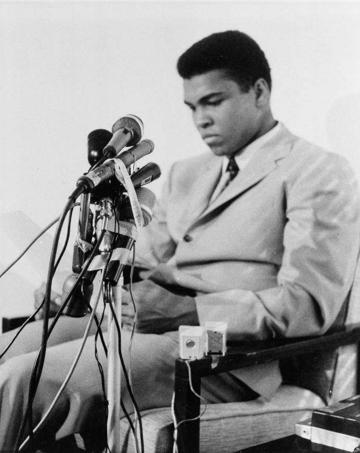 Boxer Muhammad Ali becomes a conscientious objector in 1967, saying the real enemy of his people 'is right here' in the US and not in Vietnam