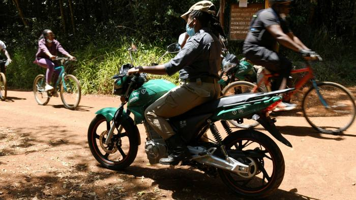 A Karura forest scout on patrol using an electric motorcycle