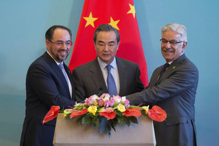 China's foreign minister Wang Yi, centre, Afghanistan's foreign minister Salahuddin Rabbani, left, and Pakistan's foreign minister Khawaja Muhammad Asif, right, at a press conference in Beijing in 2017