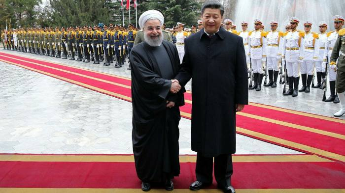 Chinese president Xi Jinping, right, with Iranian president Hassan Rouhani in Tehran in 2016. China is already Iran's biggest trade partner