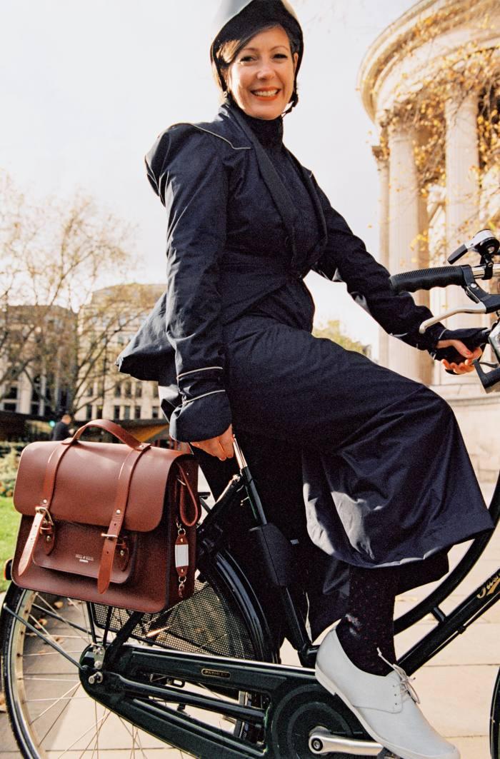 Beatrice wears Dashel Urban Cycle Helmet, £79. Georgia in Dublin Hustle & Bustle jacket, €165, and Rainwrap skirt, €63. Tracey Neuls Geek Reflective Cycle Sneakers, £150. Hill & Ellis leather Satchel Cycle Bag, £200