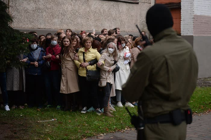 Belarusian riot police detain female opposition activists at a protest in support of their leader Maria Kalesnikava in Minsk