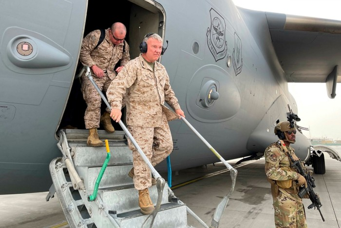 General Frank McKenzie of the United States disembarks from a C-17 Globemaster aircraft after landing at Hamid Karzai Airport in Kabul.