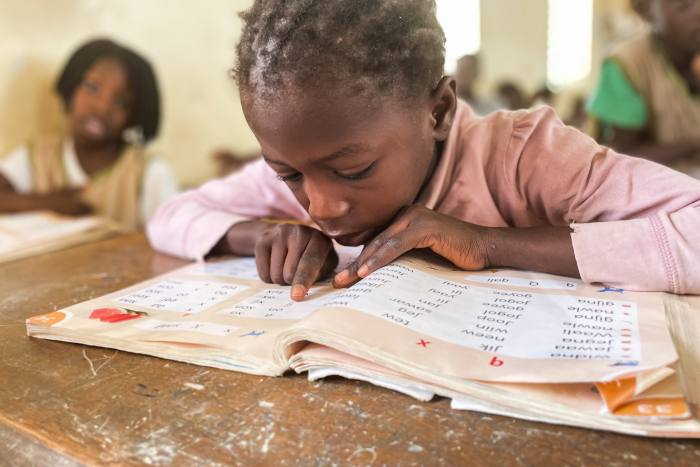 Pupils practise reading in their local language