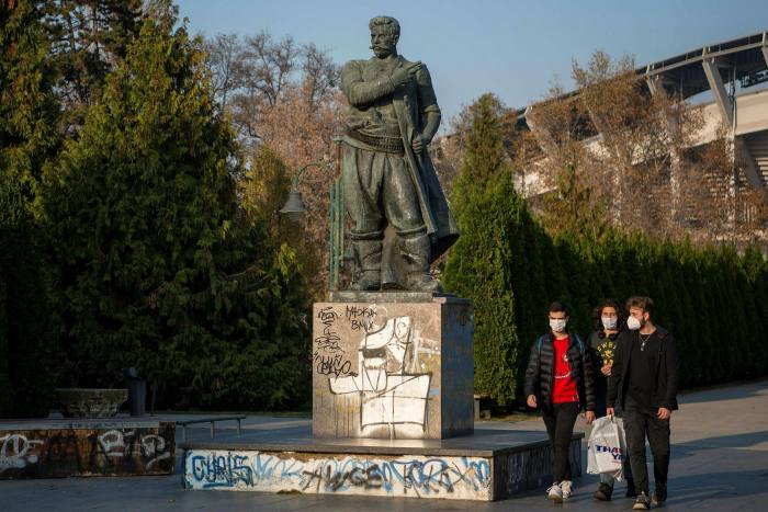 Pedestrians walk past a statue of Goce Delchev — a revolutionary figure celebrated by both North Macedonia and Bulgaria — in a park in Skopje last week