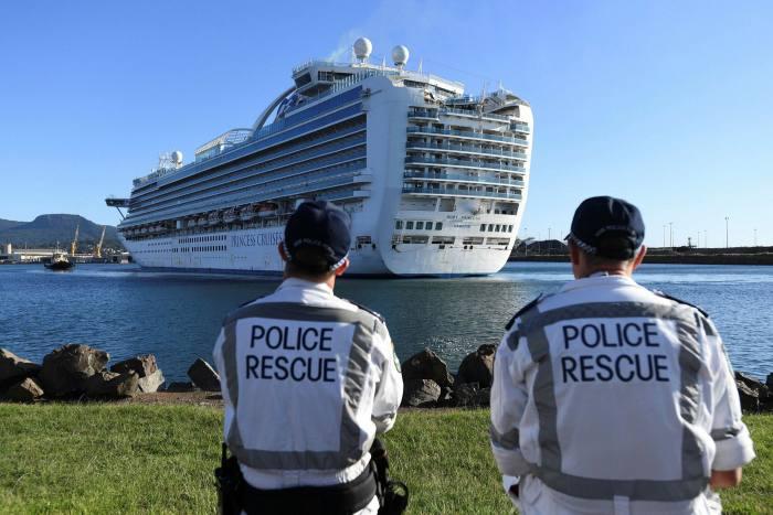 Carnival's Ruby Princess ship docks in Wollongong, Australia. Carnival says it has 32,000 crew awaiting repatriation