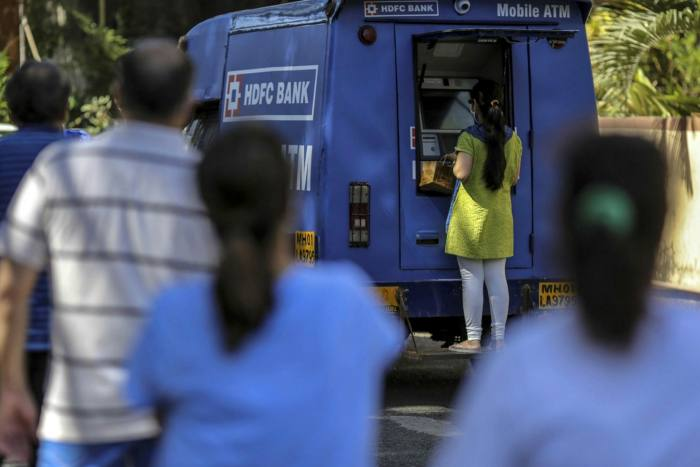 A customer uses an HDFC ATM on a van in Mumbai, India, in May 2020