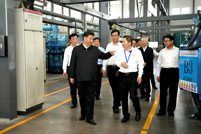 Chinese president Xi Jinping (L) has reinforced China's strategic interest in securing rare earth supplies