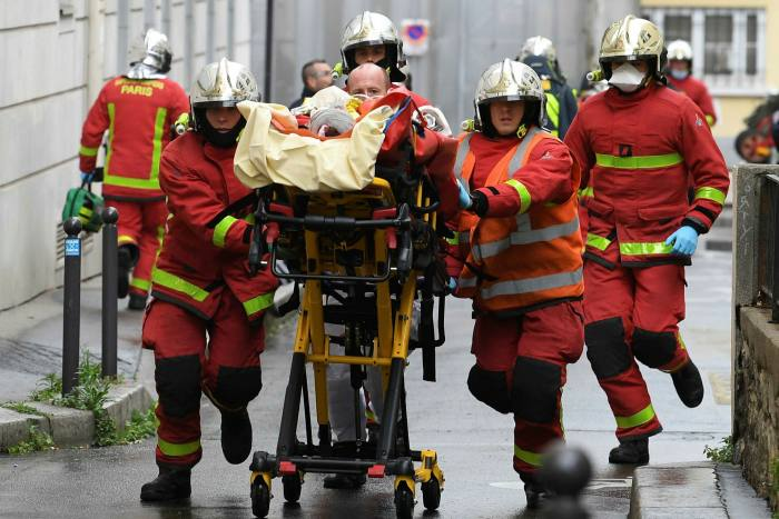 Rescue workers at the scene of the recent attack at the former offices of Charlie Hebdo. The French president's plans come as public concern about terrorism remains high