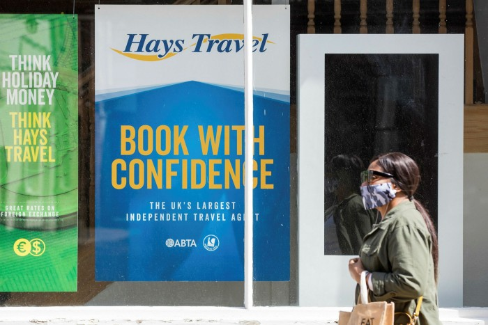 A pedestrian passes a travel agency store, operated by Hays Travel, in Canterbury, UK. The lockdown has severely hit the travel industry