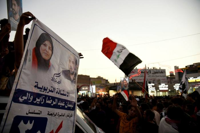 Imtidad supporters celebrate in the city of Nasiriya after promising results came in for the activist-led movement