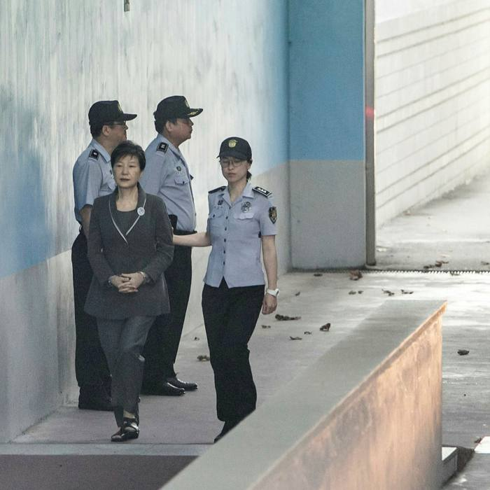 Former South Korea president Park Geun-hye is escorted by a prisonofficer at the Seoul Detention Center, where her fellow inmates include Lee Jae-yong, who was found guilty of bribing her while she was in office