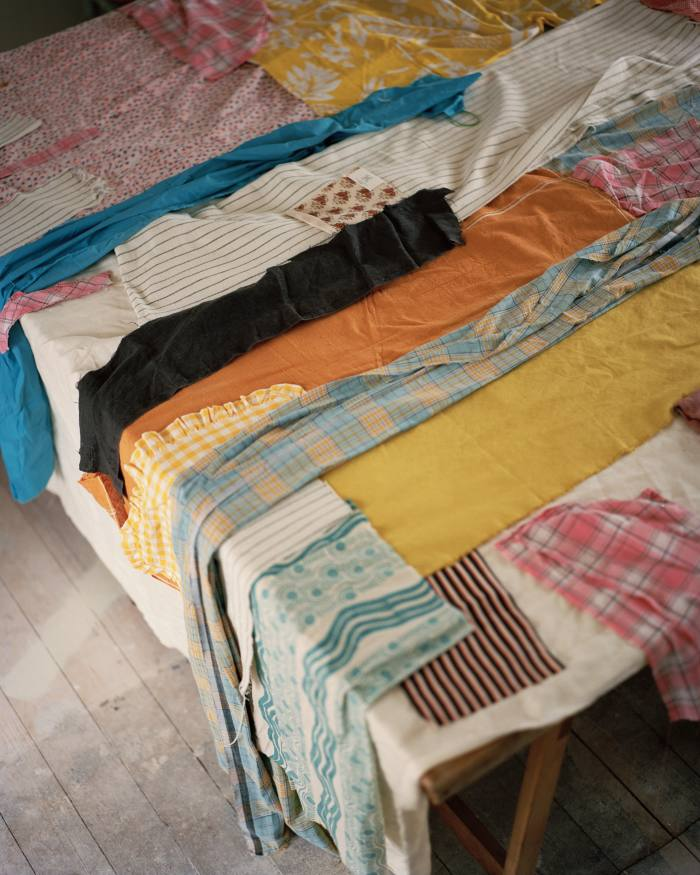 Fabric laid out as the beginning of a new patchwork piece by Kings