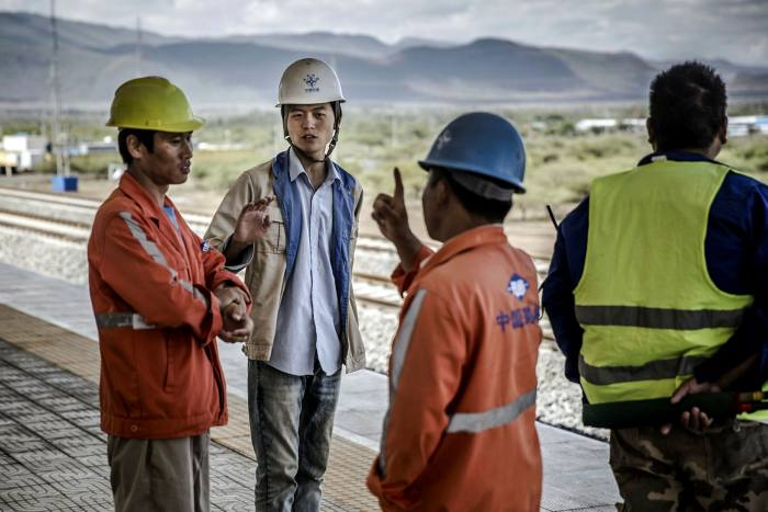 Workers on the Kenyan railway line built by China.Petroleum Group says Western countries have failed to use their energy assets to compete with Beijing for economic influence