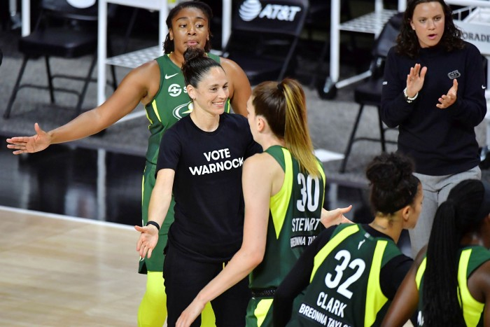 WNBA player Sue Bird wears a 'Vote Warnock' T-shirt to support Raphael Warnock, who is running for Senate in Georgia against incumbent Kelly Loffler, who is critical of the Black Lives Matter movement