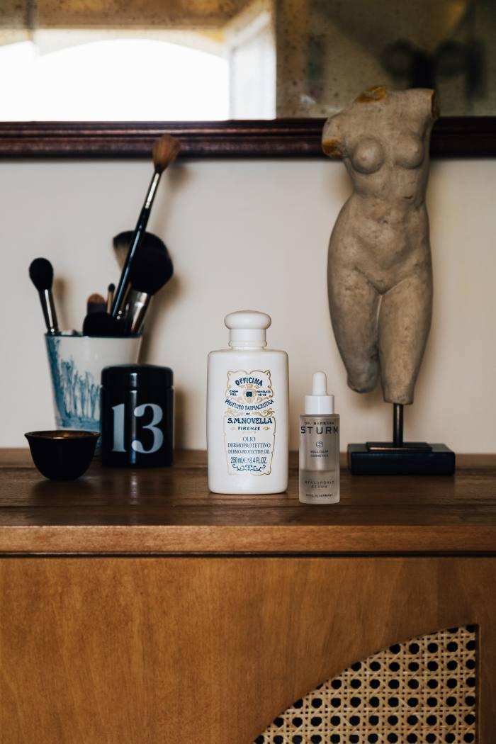 Bini's grooming staples include (centre) Officina Profumo-Farmaceutica di Santa Maria Novella Dermo-Protective Oil and (right) Dr Barbara Sturm Hyaluronic Serum