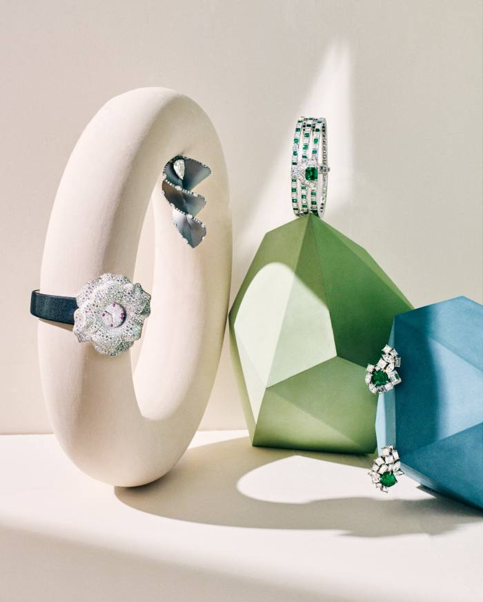 From left: Jaeger-LeCoultre white-gold, diamondand pink-sapphire Rose Extraordinaire La Rose watch on satin strap. Fabio Salini white-gold, titanium and diamond Shanghai earring (sold as a pair). Louis Vuitton white-gold, platinum, diamond and emerald Damier bracelet. Dior Joaillerie platinum, diamond and emeraldGem Dior earrings