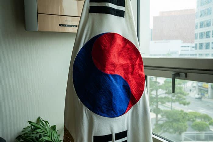 A South Korean flag hangs in Lee Soon-geum's office