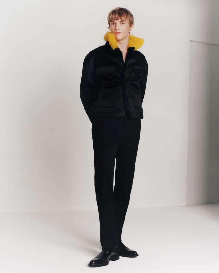 Louis Vuitton satin and shearling military jacket, £2,897, and wool trousers, £267. Ami leather Chelsea boots, £380. Model, Kerkko Sariola at Premium. Casting, Mathilde Curel for Julia Lange Casting. Hair, Rimi Ura at Walter Schupfer Management. Grooming, Marianne Agb. Photographer's assistant, Etienne Oliveau. Stylist's assistant, Thalia Duran