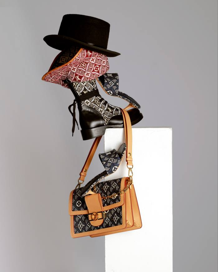 Nicolas Ghesquière reinterprets Louis Vuitton's signature print 1854 – the year the house was founded. From top: Louis Vuitton jacquard-weave and leather Since 1854 hat, £545, Metropolis Flat Rangers boots, £1,260, Revival mules, £620, and Dauphine MM bag, £2,740, louisvuitton.com