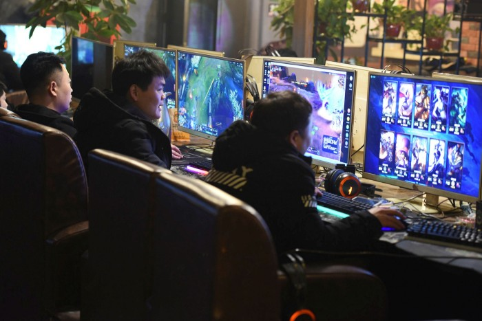People play computer games at an internet café in Fuyang. President Xi Jinping is targeting the video gaming industry, which he has criticised for increasing 'the incidence of myopia among students'
