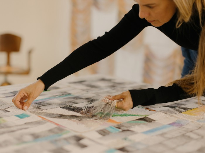 Lou works on a painting titled 'Lost Highway' (2021)