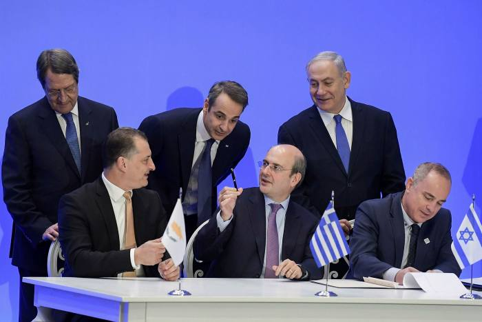 Top row: Greek Prime Minister Kyriakos Mitsotakis (C), Israel's  Benjamin Netanyahu (R) and Cypriot President Nikos Anastasiadis. Bottom row: from left, Cypriot Energy Minister Yiorgos Lakkotrypis, Greek counterpart Kostis Hatzidakis and Israeli Energy Minister Yuval Steinitz, sign an agreement for the EastMed pipeline project in January
