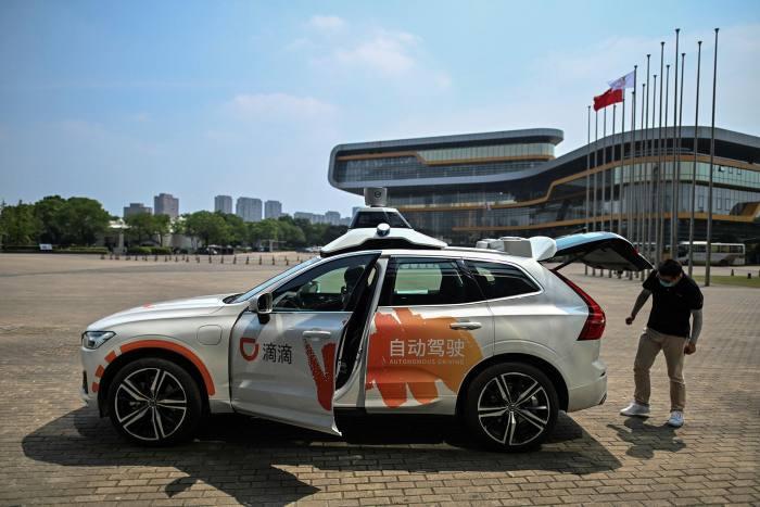 A Didi Chuxing autonomous taxi preparing for a pilot test drive