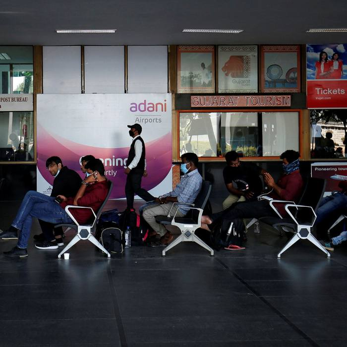 Passengers wait to board their flights after Adani Group took over operations of Sardar Vallabhbhai Patel International Airport in Ahmedabad last week
