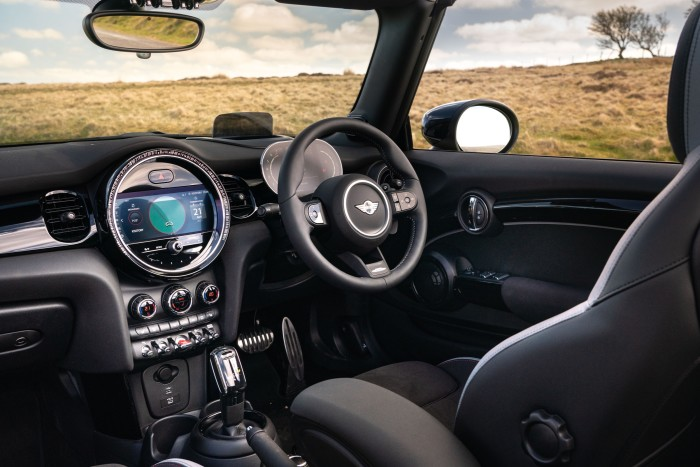 The round, centrally-placed speedometer that was a signature of the original Mini now takes the form of an infotainment system