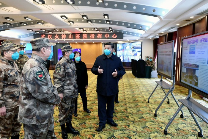 Wuhan: Officials brief Xi Jinping, right, about the Covid-19 outbreak during the president's visit in March. 'Coronavirus appears to have strengthened Xi's grasp on power,' says Jessica Chen Weiss of Cornell University