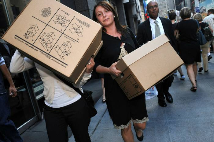 Women leave Lehman Brothers in 2008 after the bank filed for bankruptcy protection