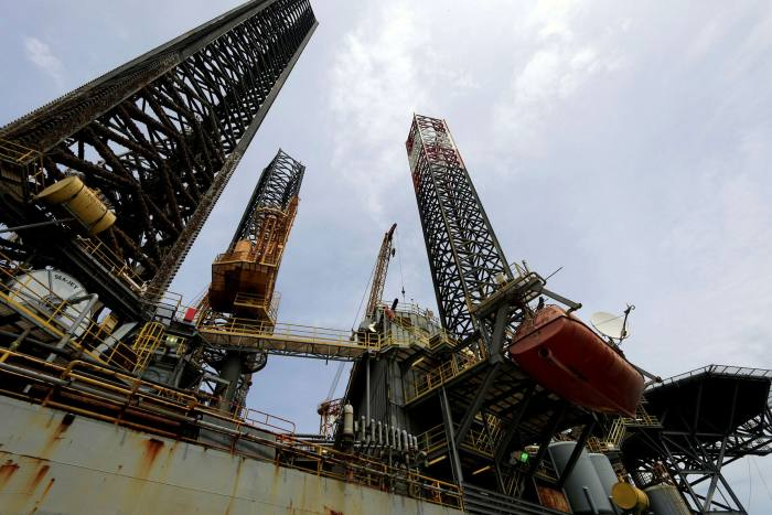 An oil platform at Puerto Bahia in Colombia. About 45 countries were expected to launch lease rounds for exploration this year, but coronavirus is expected to put certain projects on hold — from Brazil and Colombia to Thailand