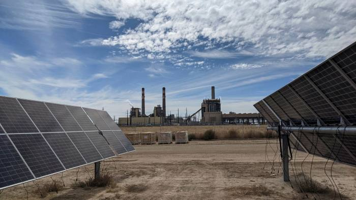 Solar panels at the Bighorn Solar project, which sits next to the Comanche coal-fired power station outside Pueblo in southern Colorado