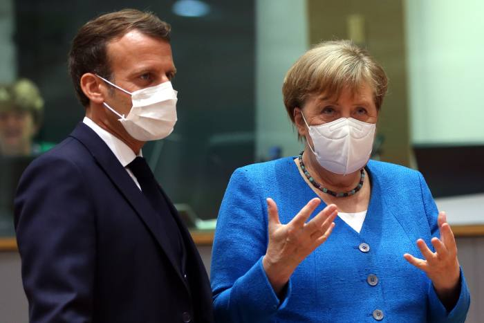 Emmanuel Macron and Angela Merkel at an EU summit to discuss the EU's long-term budget and coronavirus recovery plan, Brussels, July 18. Their May announcement was 'a total game-changer' says one French official.
