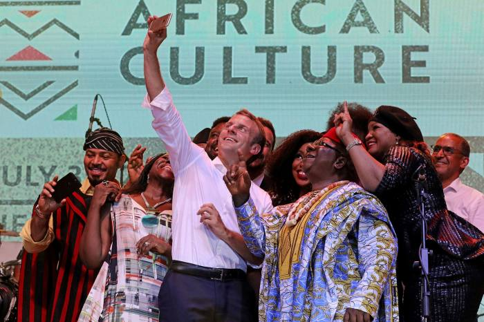 French president Emmanuel Macrontakes a selfie with Nollywood artists in Lagos. France has made progress in courting non-francophone countries outside the traditional Paris sphere of influence such as Nigeria, Kenya and Ethiopia