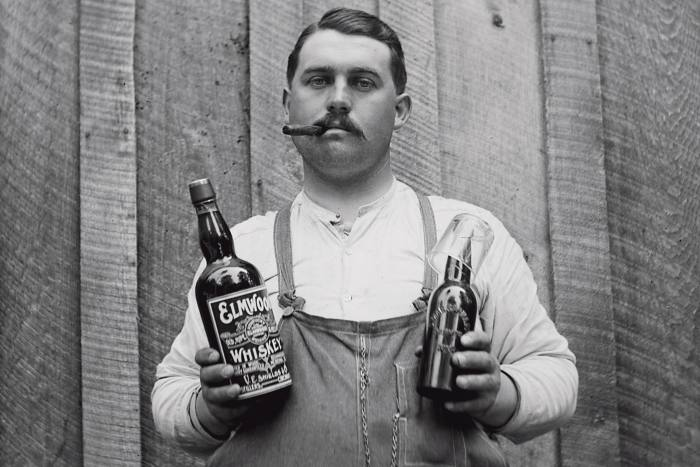 Lining up a beer and rye chaser, circa 1900