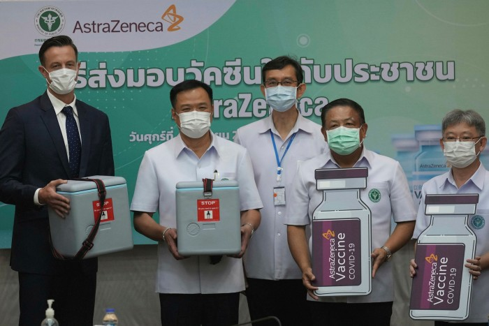 President of AstraZeneca in Thailand James Teague, (L), and Anutin Charnvirakul, health minister, (2nd L), hold mock-up AstraZeneca vaccine boxes at a press conference on the delivery of the first locally produced AstraZeneca vaccines at the Public Health Ministry in Nonthaburi province last week