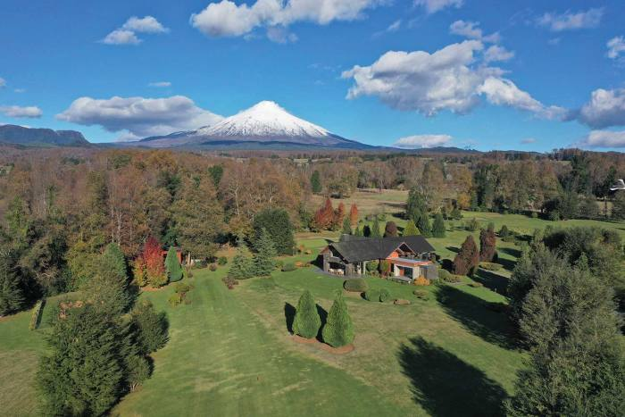 Casa Pucón in Chilean Patagonia's Lake District, with Villarrica volcano behind