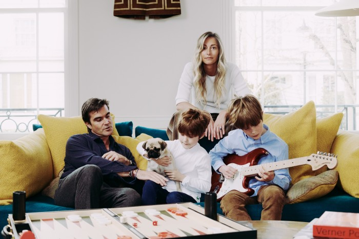 Dawn Russell at home in London with herhusband Jamie, Tinto the dog and children Leo and Alexander