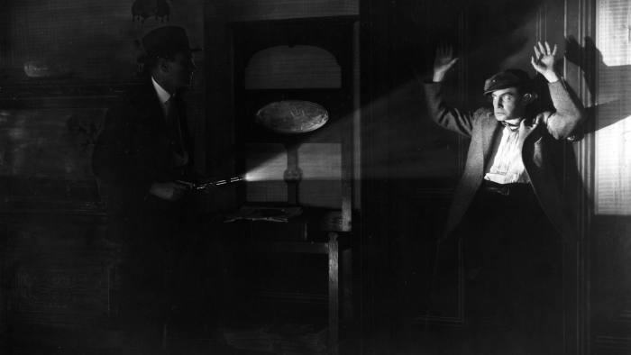 12th March 1928: A scene from the stage play 'Square Crooks', in which a burglar is caught in the act. The play was performed at the Prince of Wales Theatre in London