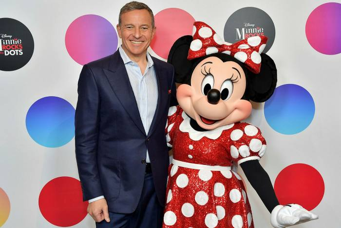Bob Iger, pictured at a ceremony for Minnie Mouse in 2018, recently told friends that Disney's future is streaming and theme parks, rather than channels.