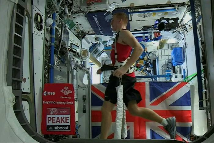 British astronaut Tim Peake running on treadmill at the International Space Station in 2016