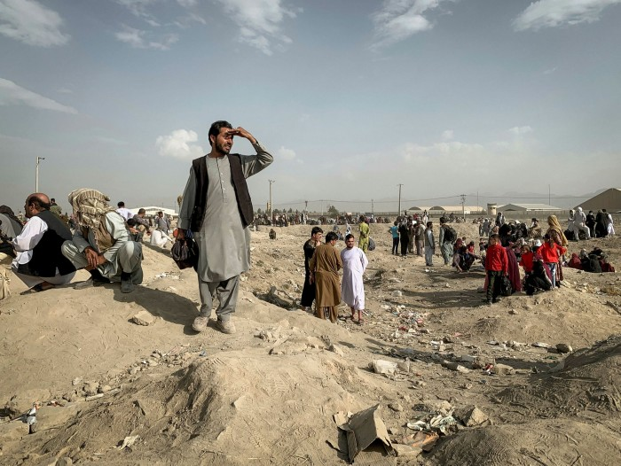 People gather near the north gate of the airport in Kabul, August 21